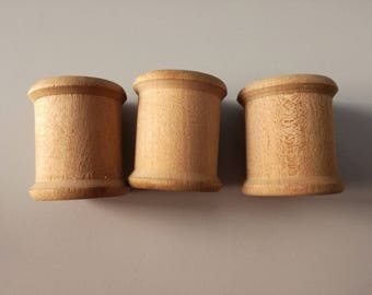Old wooden thread coils