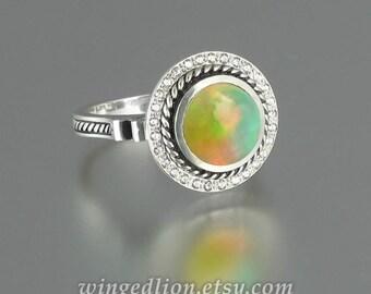TATIANA 14K gold ring with Opal and diamond halo