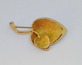 Decorative gold colour brooch