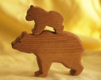 A wooden bear cub with his mother
