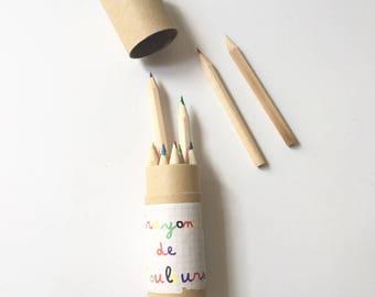 Colored pencils children wooden pot