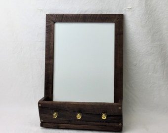 A  dry erase board with a letter box and  decorative key holders.  Handcrafted from Black Walnut wood.