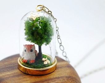 under the night owl's tree story dome necklace. miniature clay owl, miniature tree on grassy moss