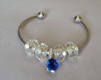 Silver Tone Bangle with Crystal Facets Spacer Deads and European Silver Charm