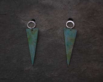 silver and brass geometric patinated studs