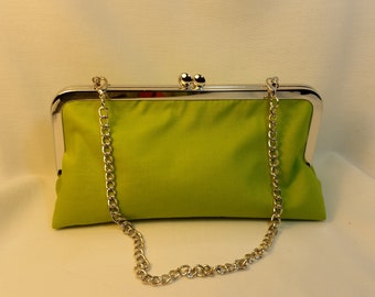 Neon green/ neon green interior clutch with metal frame