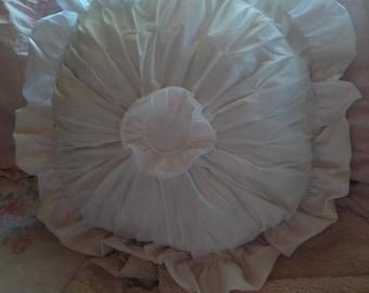 white round ruffled pillow