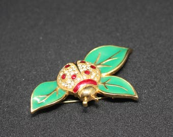Rhinestone Lady Bug on Green Enamel Leaves Vintage Brooch With Marking LC.