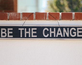 Be The Change Weathered Sign
