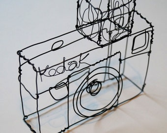 Wire sculpture of an old Kodak camera
