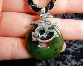 Silver dragon and nephrite jade pendant