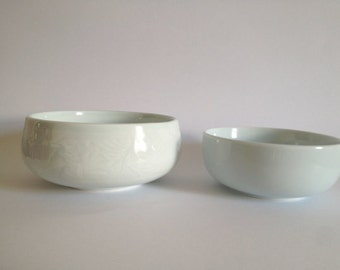 two celadon bowls