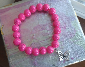Bright pink glass bead stretch bracelet with a Tibetan silver butterfly charm, 10mm, neon pink, hot pink, gift for her