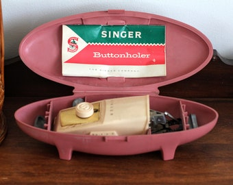 Vintage Singer Buttonholer Sewing Machine Attachment in Pink Plastic Carrying Case
