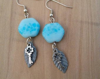 Dangle earrings with key and leaf