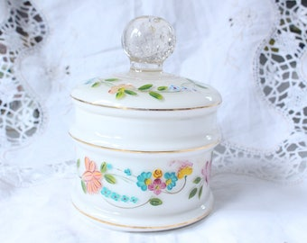 Hand painted opaline glass jar with a pretty floral design