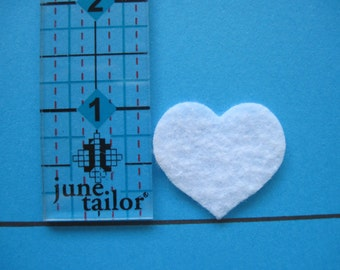 """White felt Hearts -- 1"""" tall (2.5 cm) Die cut. Ready to ship. Great for crafts, wax dipping, etc. These can be dyed with markers."""