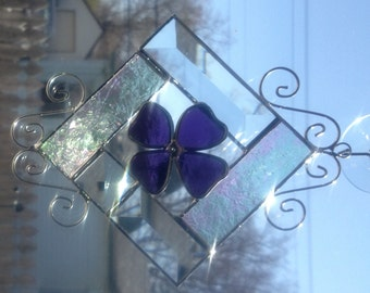 Stained glass suncatcher, purple flower, bevels, iridescent glue chip, wire scrolls.
