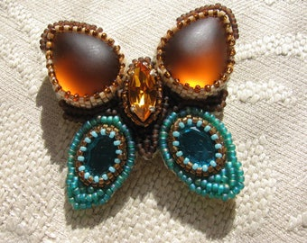 Butterfly cabochon and beadwork brooch