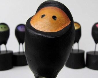 Paper Mache Orange Ninja Easter Egg  on wooden block