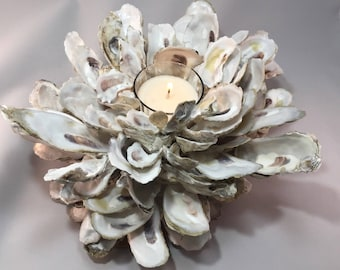 Oyster shell sculpture with candle