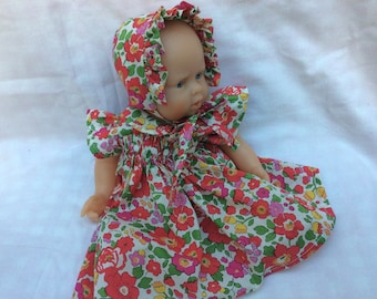 dress has smocked Liberty Betsy pink red doll 30 cm