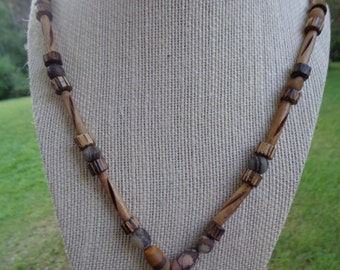 "Beautiful and earthy, 24"" necklace featuring a wood jasper stone pendant, wood jasper stone beads, bone hair pipe tubes, and cocoa wood"