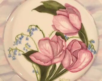 Handpainted porcelain plate with pink tulips and tiny blue bell flowers