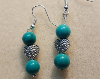 Genuine turquoise beads in these beautiful earrings.