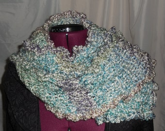Soft,warm, long/infinity crochet scarf.  Home made from Homespun  yarn.  Made in the USA.  shades of sea green, blue, and white.