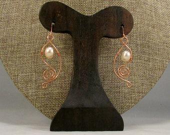 Pink pearl earrings with copper swirls