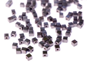20 cubes are Hematite, charcoal grey, 3 mm