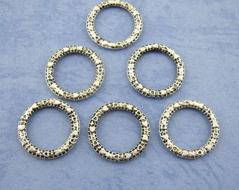 Closed rings (x 16) silver metal hearts pattern