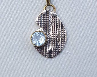 Sterling silver abstract design pendant 92.5% with sky blue topaz stone studded