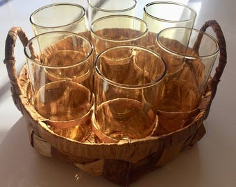 Vintage yellow drinking glasses in a basket