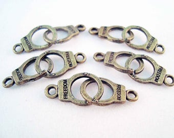 a pair of handcuffs charm bronze 30 mm