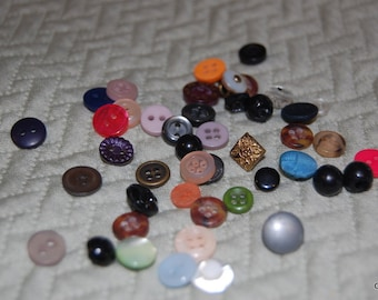 an assortment of tiny diminutive buttons  #0080