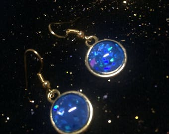 Earrings dangle earrings, round shaped, glass cabochon, glitter, gold and blue iridescent glitter, hologram.