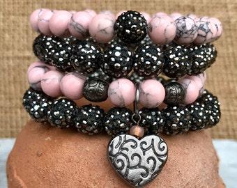 Pink and dark gray rhinestone stacking bracelet set. Rhinestone pave beads, pink turquoise and gunmetal heart charm. Boho bling stacker set