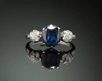 Vintage natural sapphire and diamond three stone platinum trilogy ring