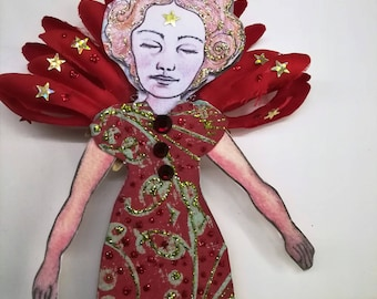 Red angel. Fairy. Paper craft. Paper angel Red and gold angelic decoration.