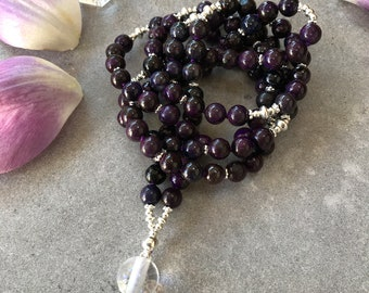 Mala from sugilite, decorated with silver, final pearl of rock Crystal