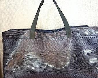 Blue snake vinyl tote bag