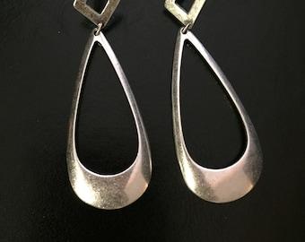 Silver tone dangle earrings