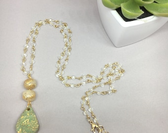 Beautiful teardrop pendant necklace with gold detail, celery green