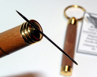 Needle case holders using a variety of exotic and local timbers