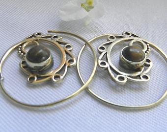 Metal disc earring is handpainted in black color