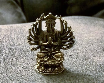 brass sitting buddha with 18 hands
