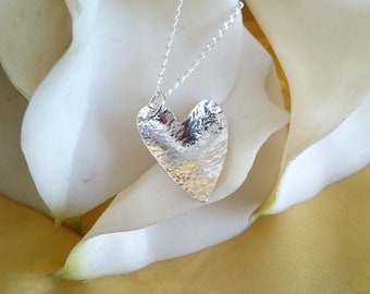 Sterling silver hammered domed heart necklace