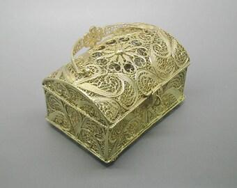 A stunning gilt filigree jewelry box. Continental.